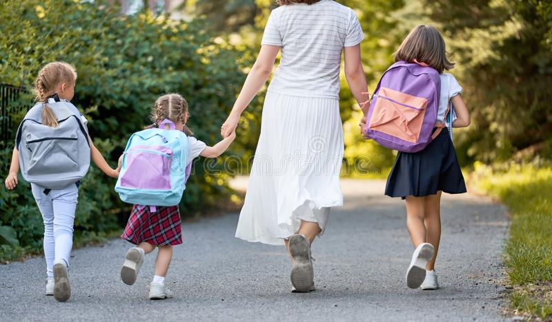 Parent and pupils are going to school royalty free stock images