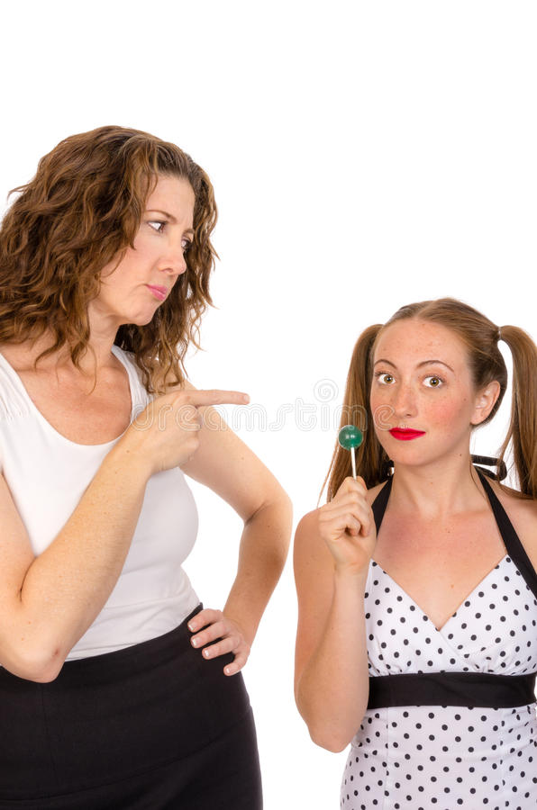 Parent scolding her daughter isolated on white. A parent scolding her teenaged daughter stock images