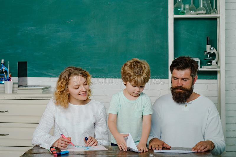 Parent taking child to school. Pupil learning letters and numbers - mathematics concept. Happy family. First day at. School. Home Family math schooling stock images
