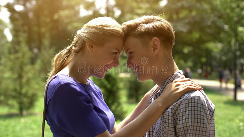 Parental support, caring mother looking at her teenage son with love, trust royalty free stock photos