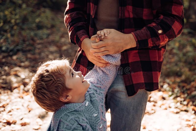 Parental support. Help kid explore world. Dad hold hand of little boy. Manly father upbringing little child. Trust and royalty free stock photography