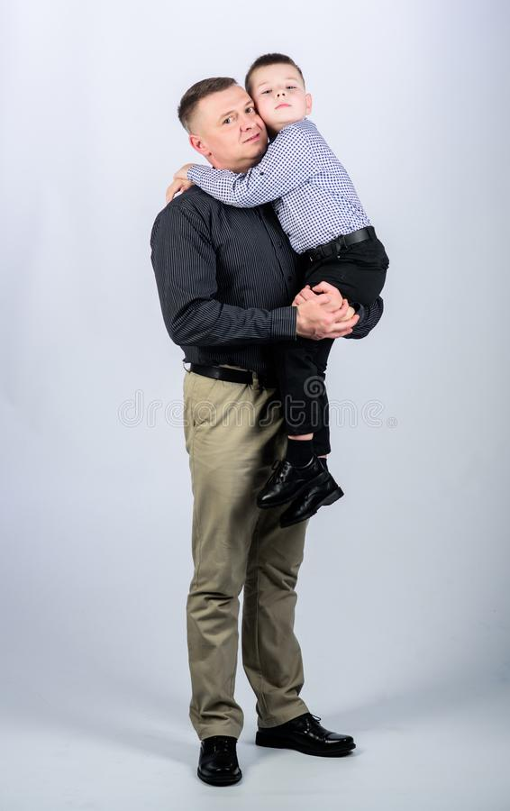 Parenthood concept. Fathers day. Father example of noble human. Family bonds. Family support. Real men. Trustful. Relations father and son. Father little son royalty free stock photography