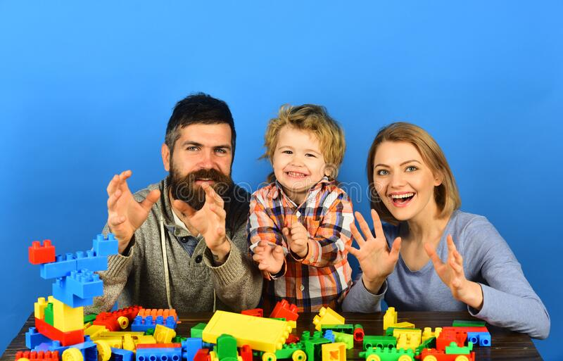 Parenthood and game concept. Man with beard, woman and boy royalty free stock images