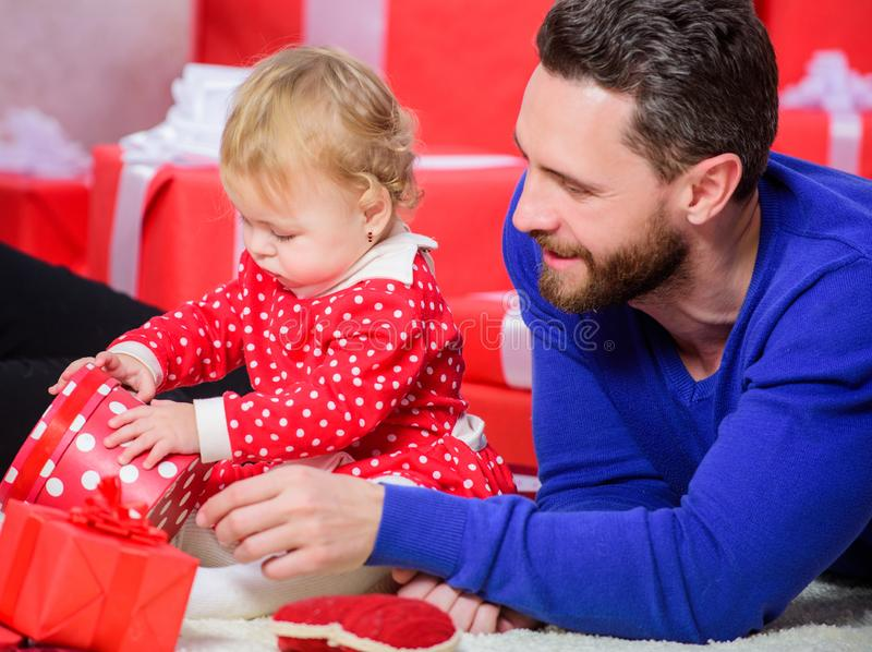 Parenthood goals. Endless love. Parenthood as challenge and achievement. Father play with cute baby toddler daughter. Celebrate first birthday. Happy stock photos