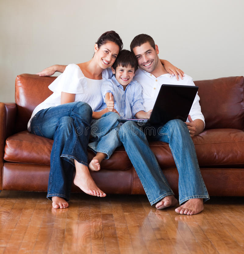 Free Parents And Kid Using A Laptop With Thumbs Up Stock Photos - 10067083