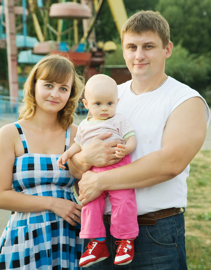 Download Parents with baby stock photo. Image of casual, green - 15689574