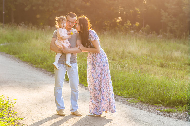 Parents with baby in park royalty free stock photo