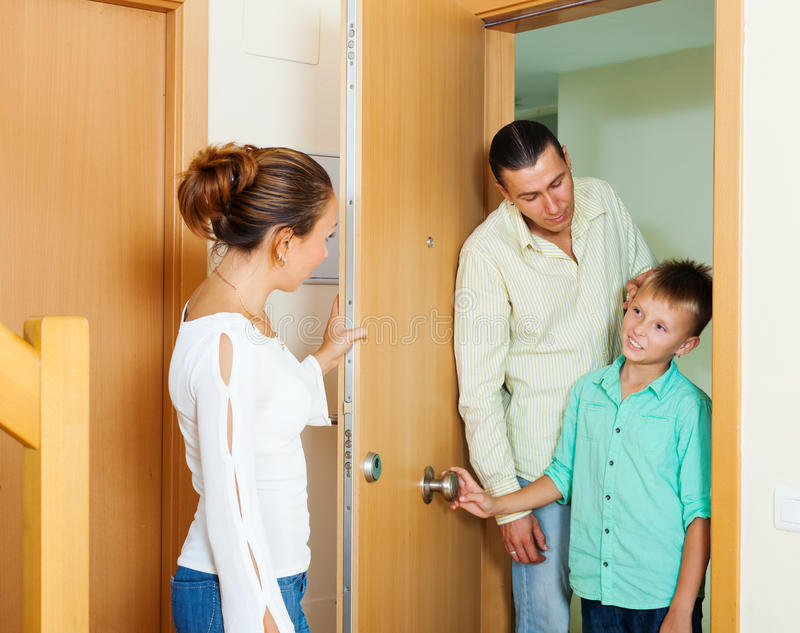 Parents berating his teenager son stock image