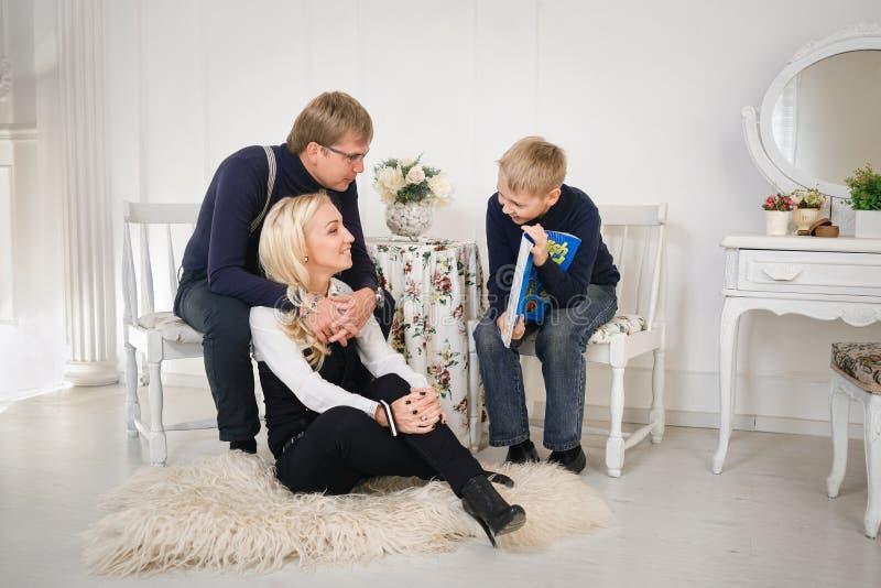 Parents checking their son`s homework. royalty free stock photo