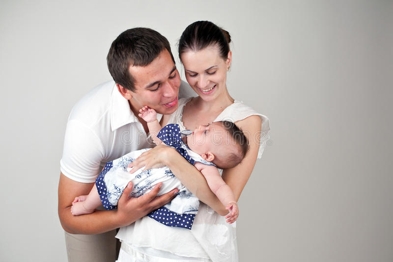 Parents with a child. An image of happy parents playing with their child stock photos