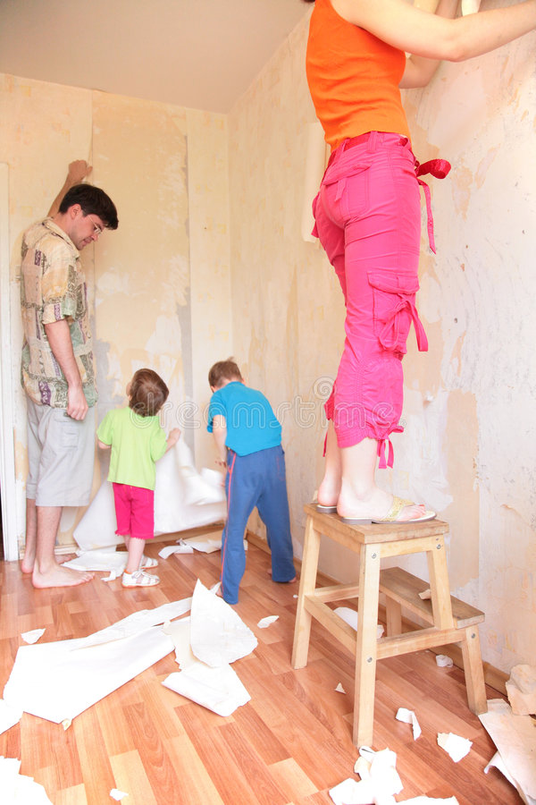 Parents with children break wallpapers from wall royalty free stock photography
