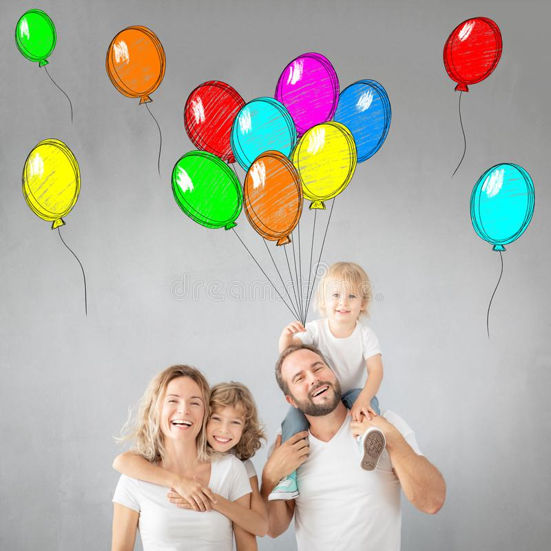 Parents with children having fun at home stock image