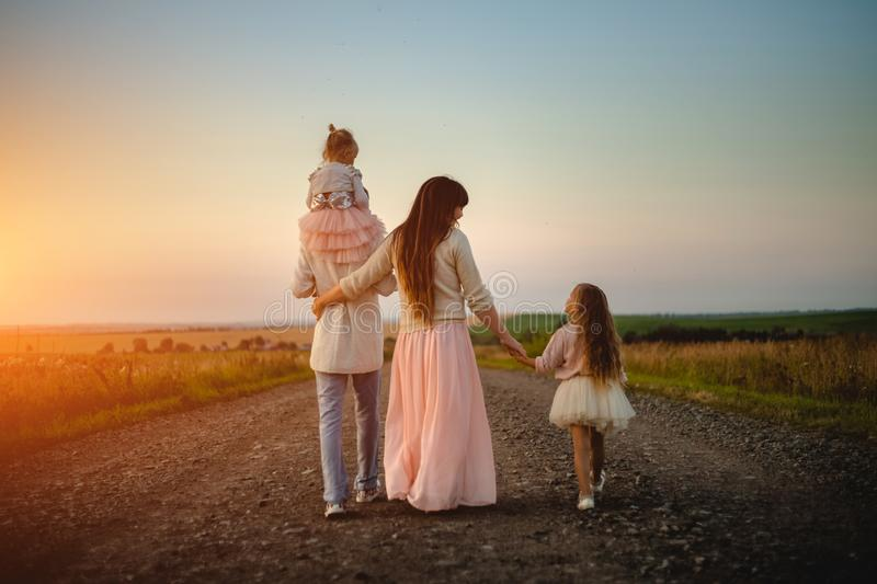 Parents and children outdoor at sunset royalty free stock photos