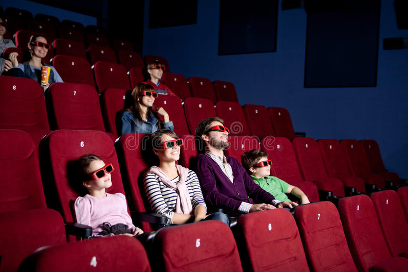 Parents With Children Watching A Comedy Stock Photo