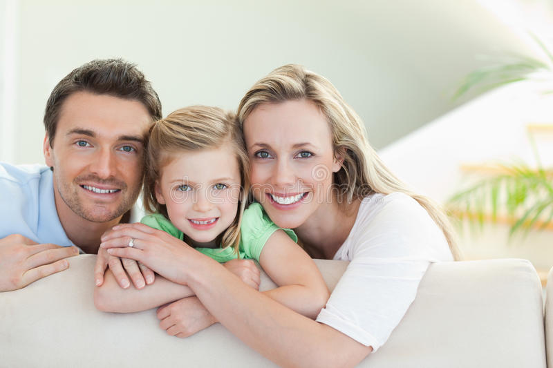 Parents with daughter on the couch. Parents together with daughter on the couch stock photography