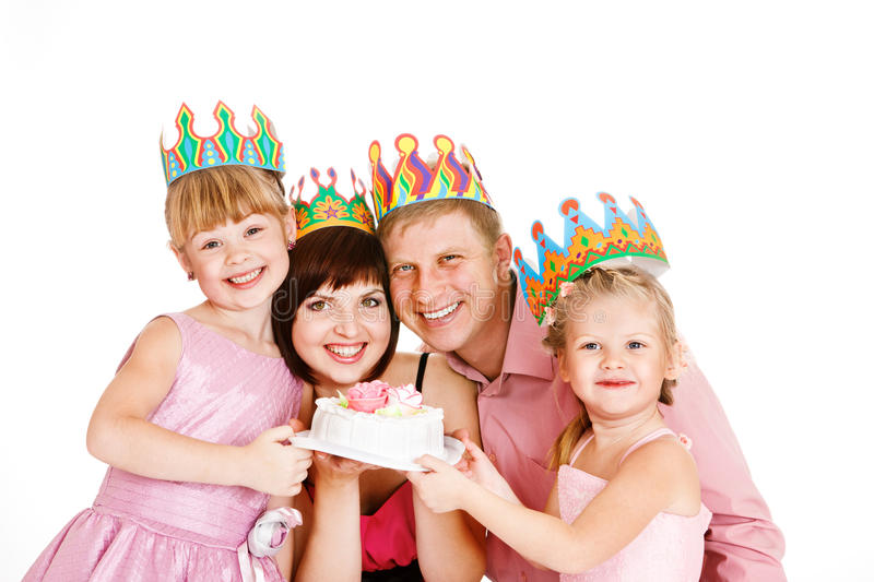 Parents and daughters holding a cake royalty free stock image