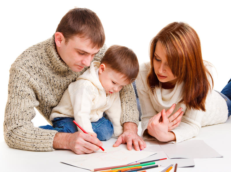Parents drawing with son stock image