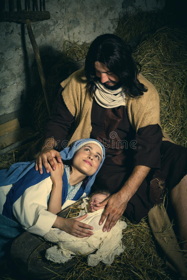 Parents fatigués dans la scène de nativité de Noël photo stock
