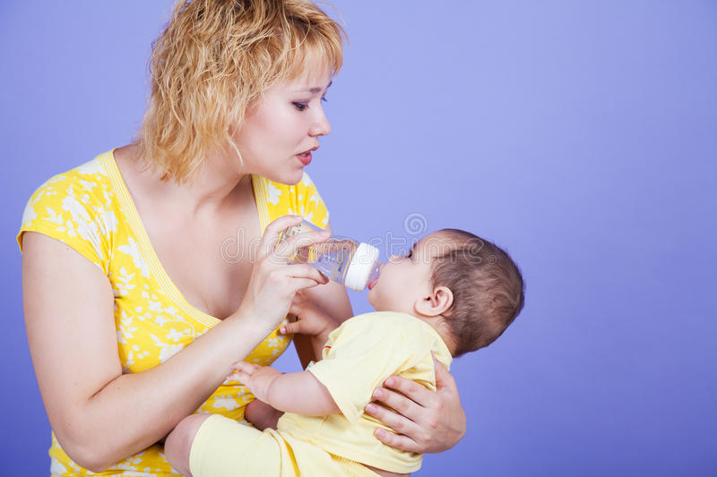 Parents fed by baby bottle stock photos
