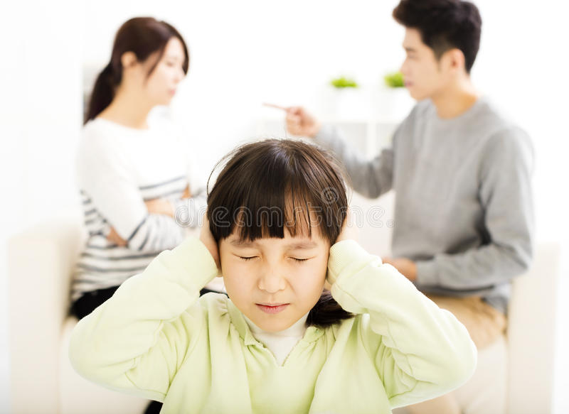 Parents fighting and little girl being upset. Asian Parents fighting and little girl being upset royalty free stock images