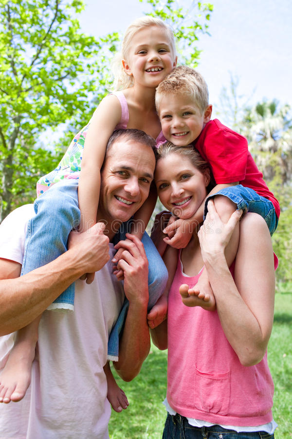 Download Parents Giving Their Children Piggy-back Ride Stock Photos - Image: 12724933