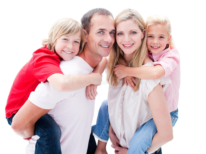 Parents giving their children piggyback ride royalty free stock photography