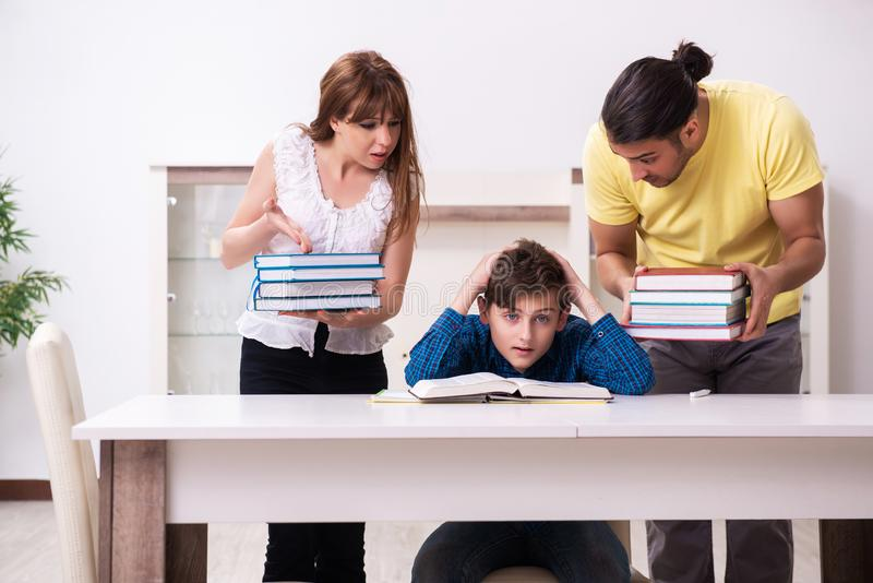 Parents helping their son to prepare for school royalty free stock images