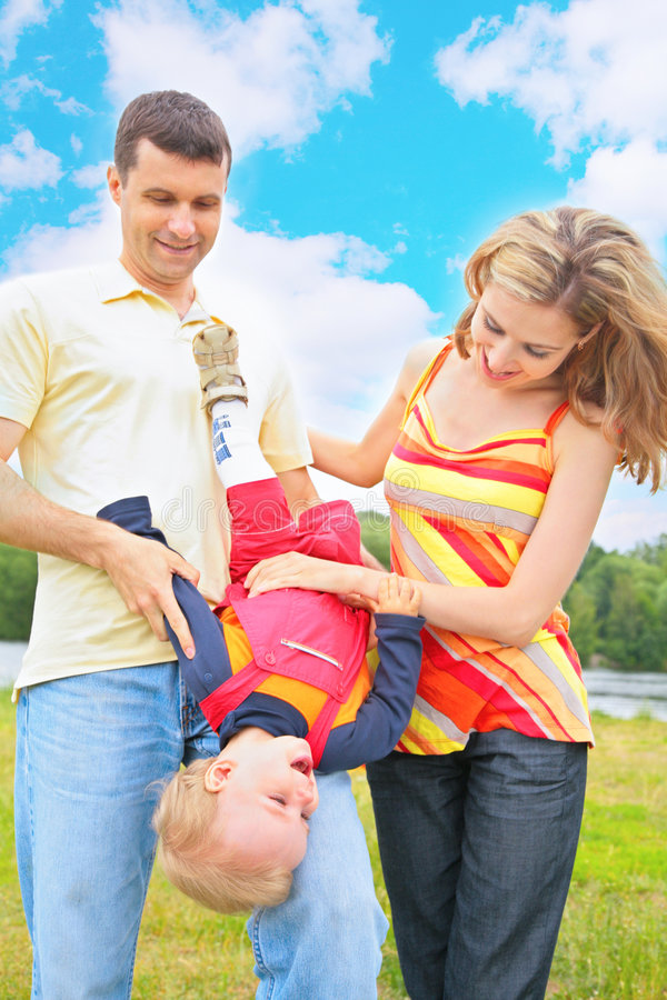 Parents Hold Child Beneath By Head Royalty Free Stock Photo