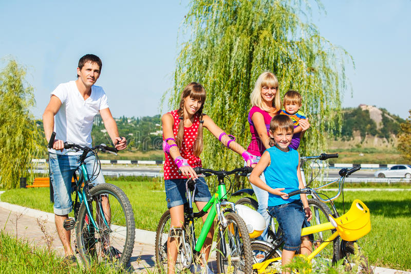 Parents and kids cycling stock photo