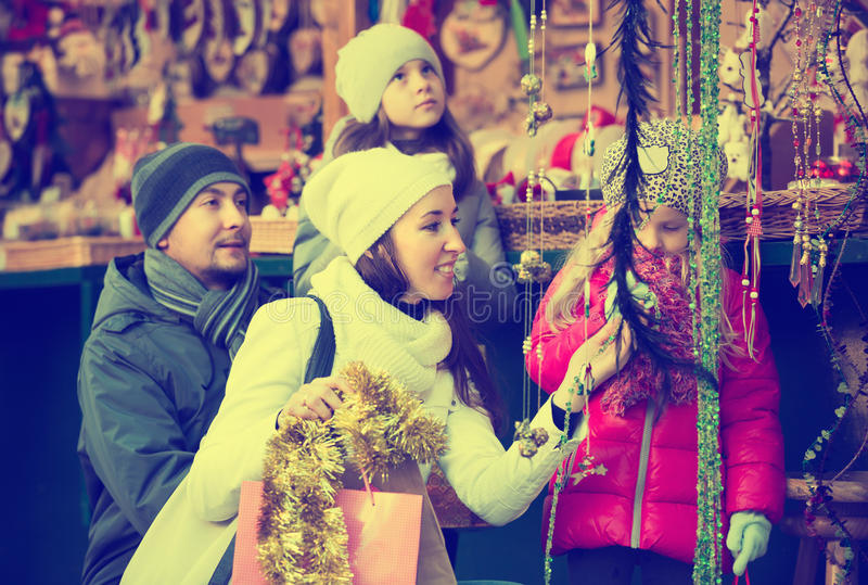 Parents with kids at X-mas market royalty free stock photo