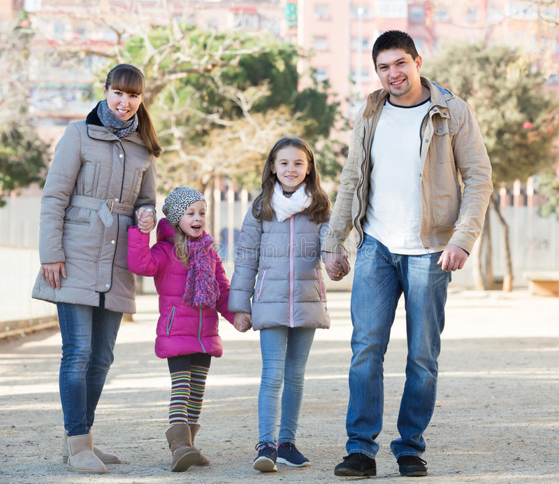 Parents with kids walking in the street royalty free stock photography