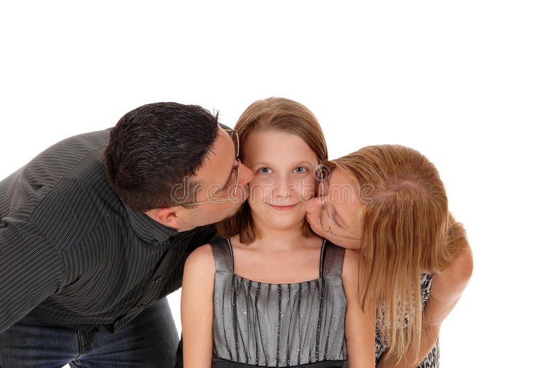 Parents kissing there daughter. A closeup picture of a couple kissing there young daughter on the chick, isolated for white background royalty free stock photography