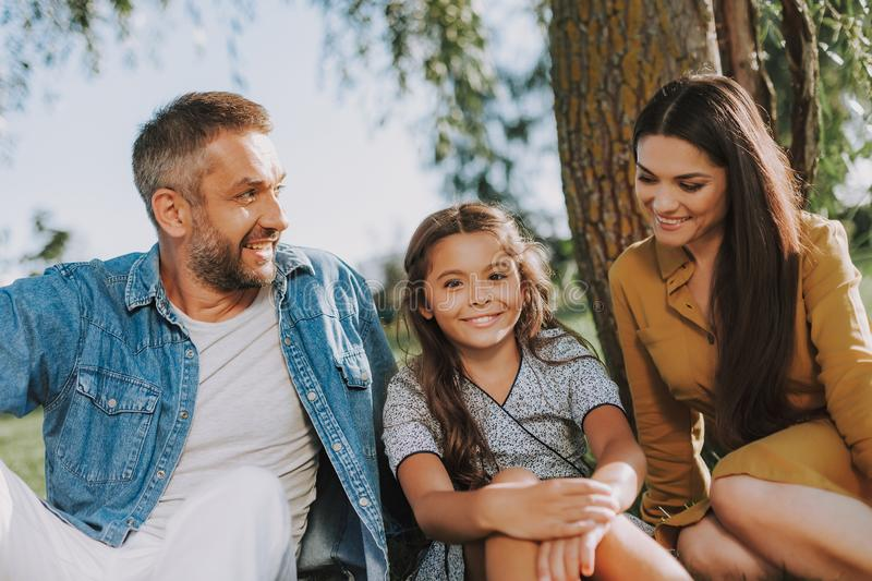 Parents and little daughter having rest together stock image