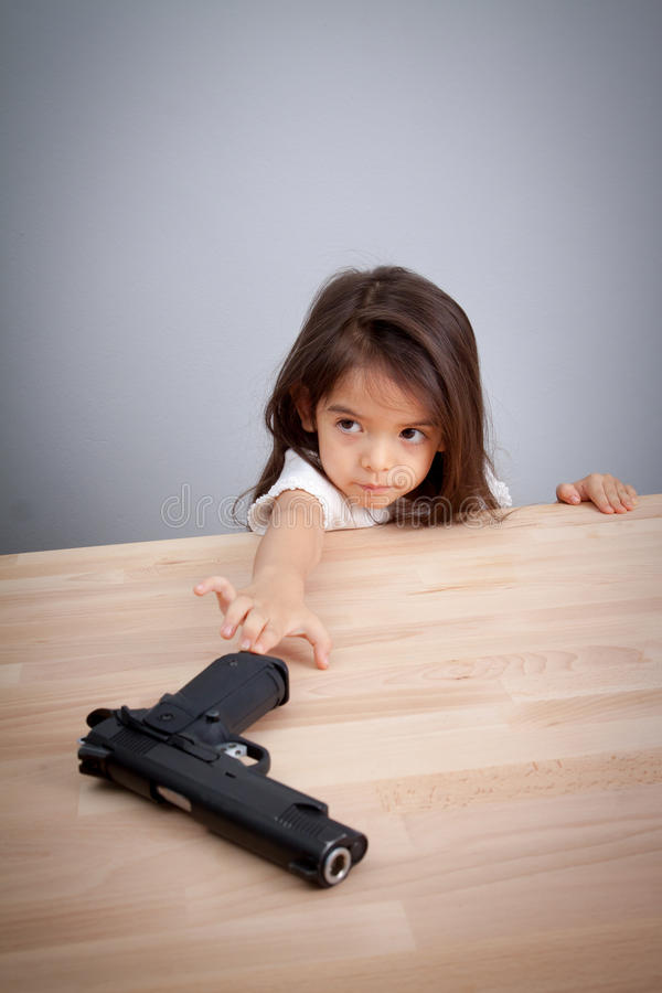 Parents not keep gun in safe place, children can have gun for accident. safety concept stock images