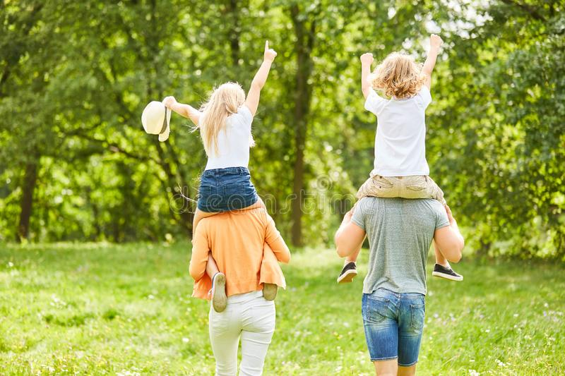 Hike with children piggyback royalty free stock image