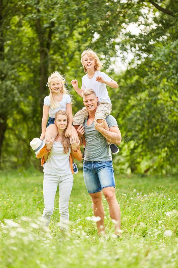 Parents piggyback their children royalty free stock images