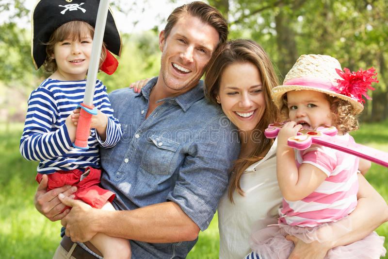 Download Parents Playing Adventure Game With Children Stock Photo - Image of flowery, laughing: 26104746
