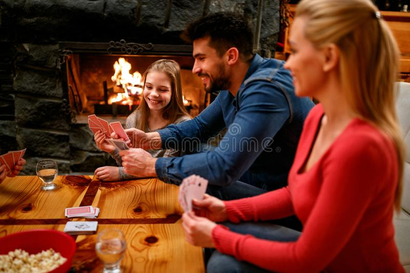 Parents playing cards with kids royalty free stock photography