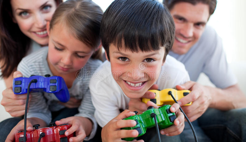 Parents playing video games with their children stock images