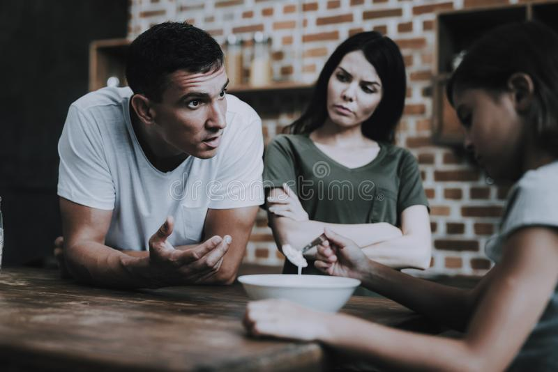 Parents Scold Girl who Avoid Eating Breakfast royalty free stock photo