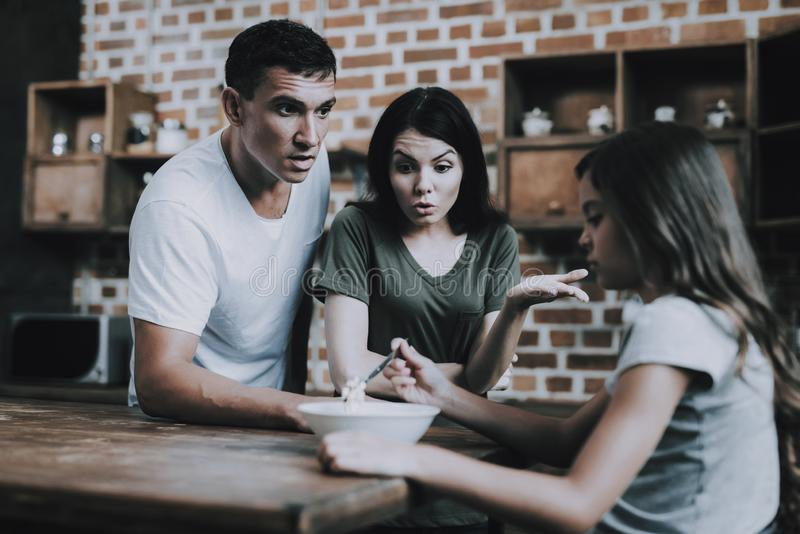 Parents Scold Girl who Avoid Eating Breakfast stock images