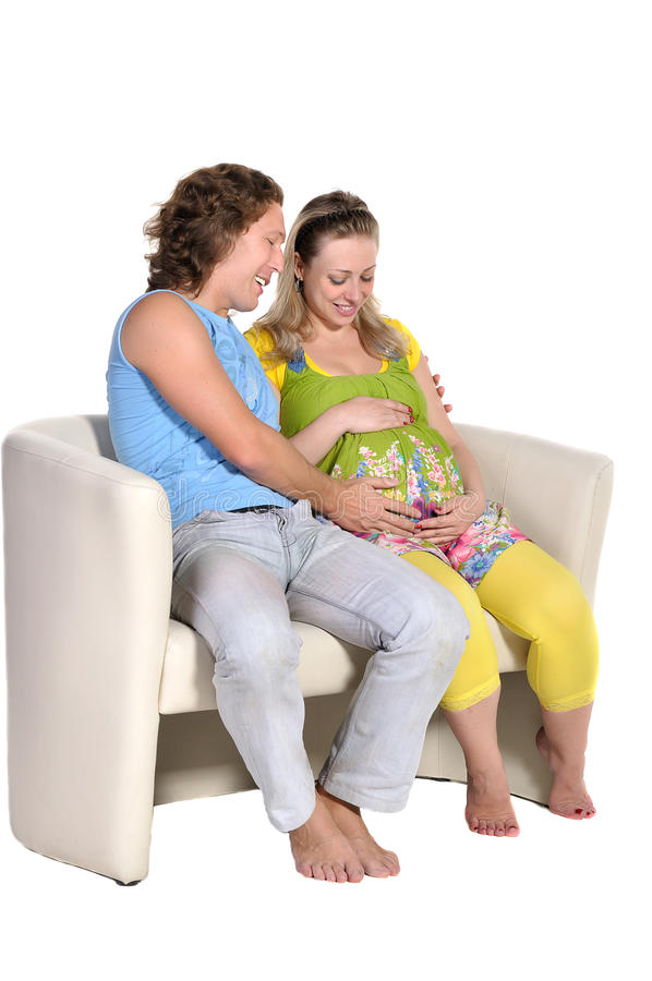 Download Parents Are Sitting On A White Couch Stock Image - Image: 25146573