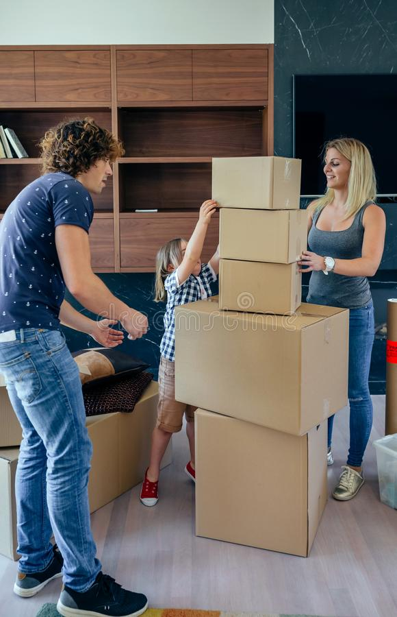 Parents with child helping to make move royalty free stock image