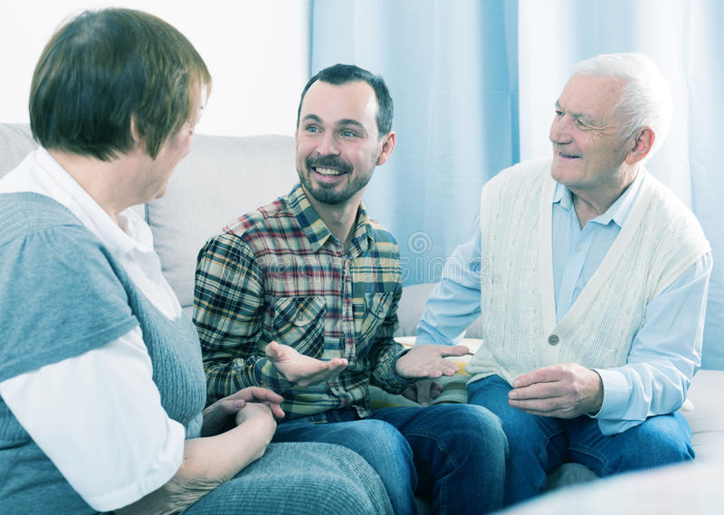 Parents and son enjoying evening royalty free stock images