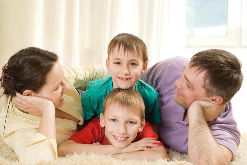 Download Parents And Their Children Lie Royalty Free Stock Image - Image: 14512176