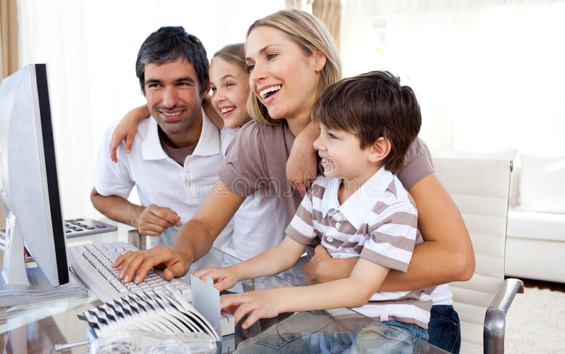 Parents and their children using a computer stock photos