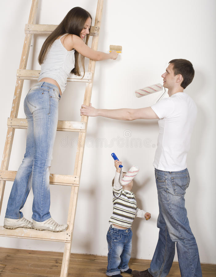 Parents with their son near ladder. Portrait of happy family doing repair, parents with their son near ladder royalty free stock photos