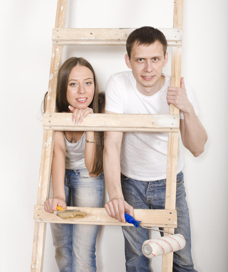 Parents with their son near ladder. Portrait of happy family doing repair, parents with their son near ladder royalty free stock images