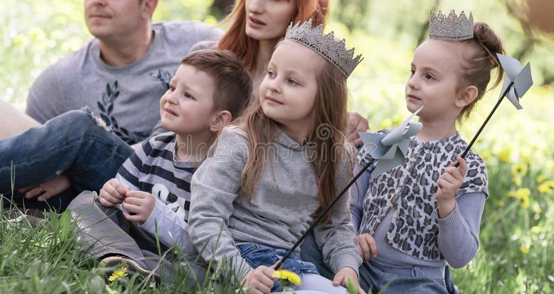 Parents and their young children spend the weekend together. stock image