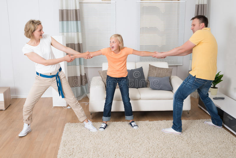 Parents under divorce dividing kids royalty free stock image